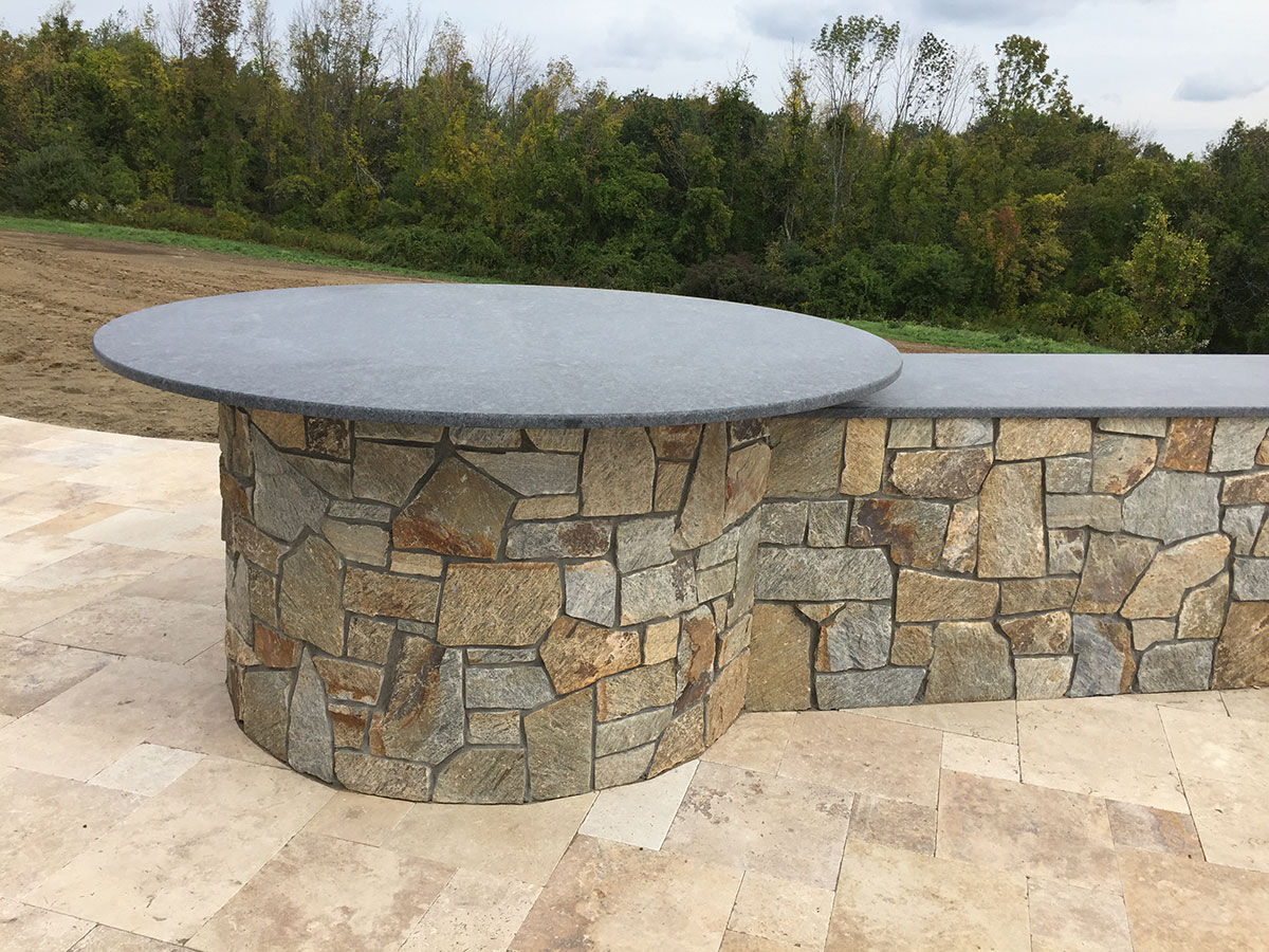 Stone outdoor table and wall