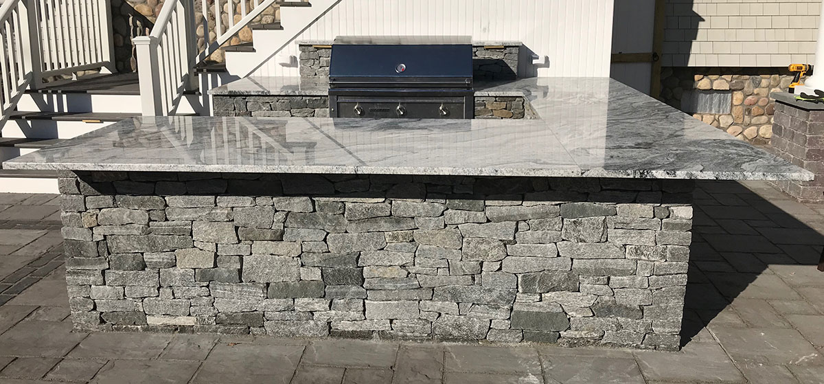 outdoor stone grilling and kitchen area
