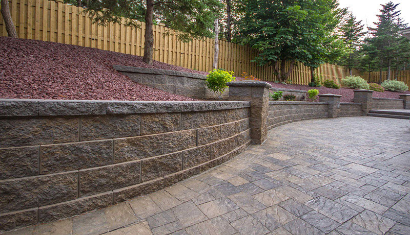 Stone mulch wall