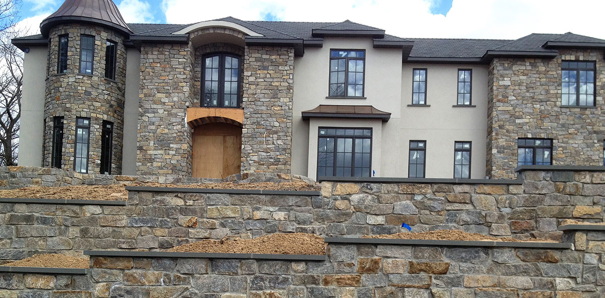 Stone wall and home
