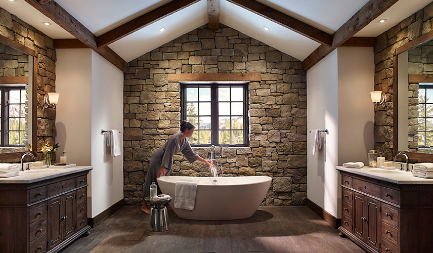 Indoor stone bathroom with tub