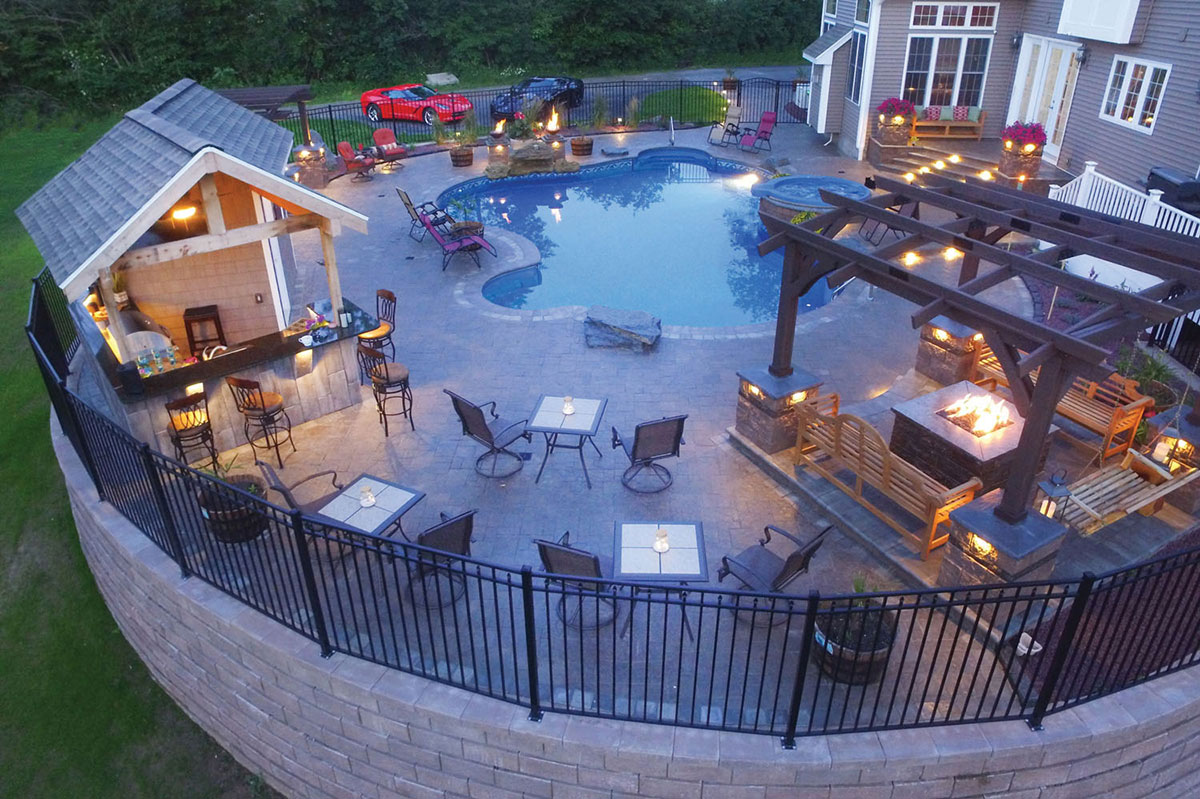 Full patio with nightlife and pool