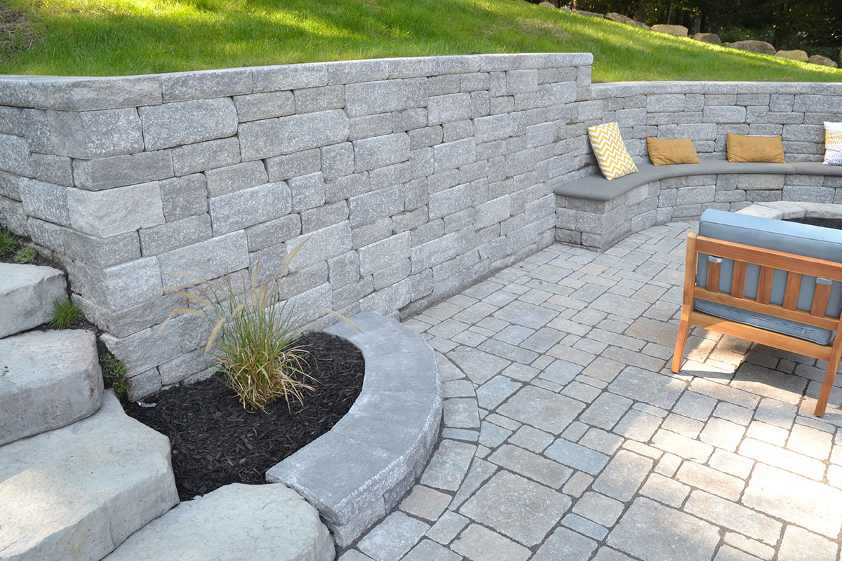 Stone patio and wall with steps and seating