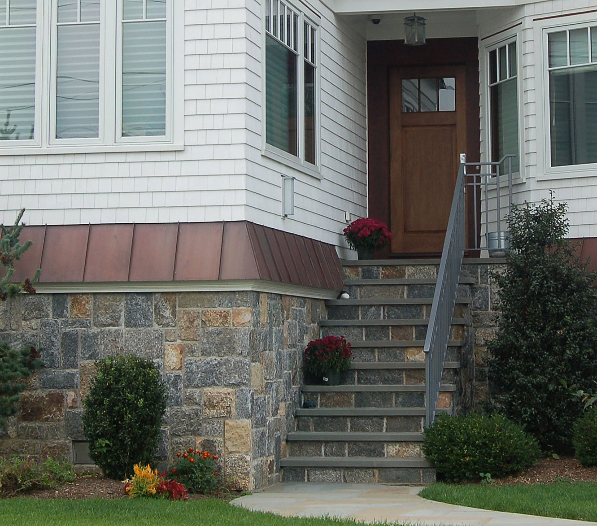 Exterior stone half wall and stairs