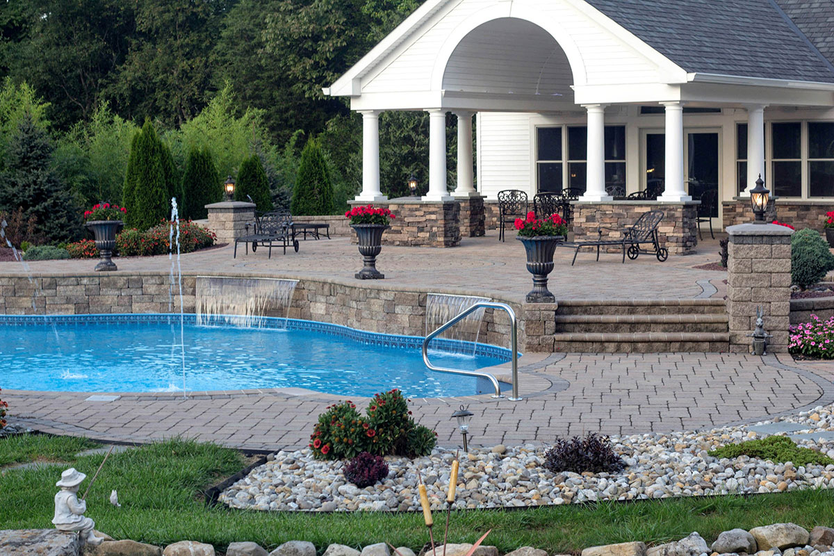 Stone patio and pool side