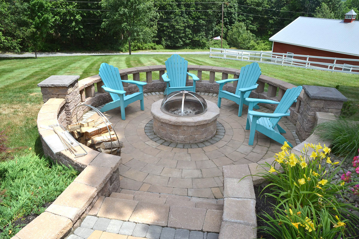 Stone bonfire area with chairs