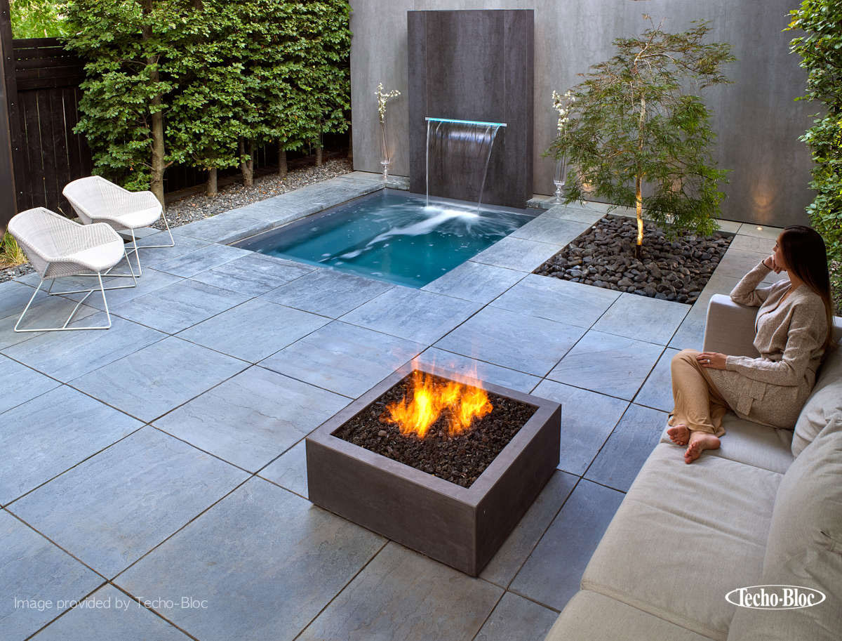 Stone area with fountain, couch and fire