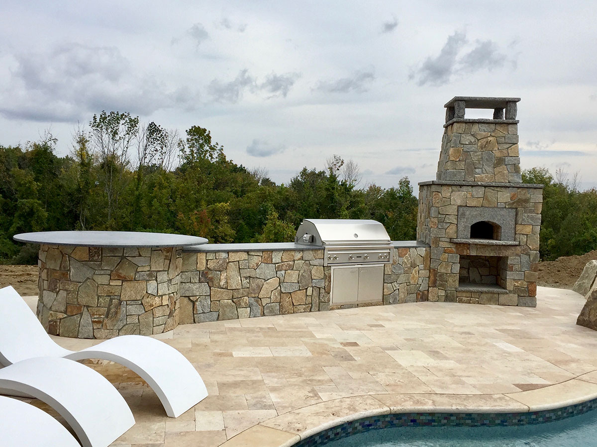 Stone outdoor oven and grilling area