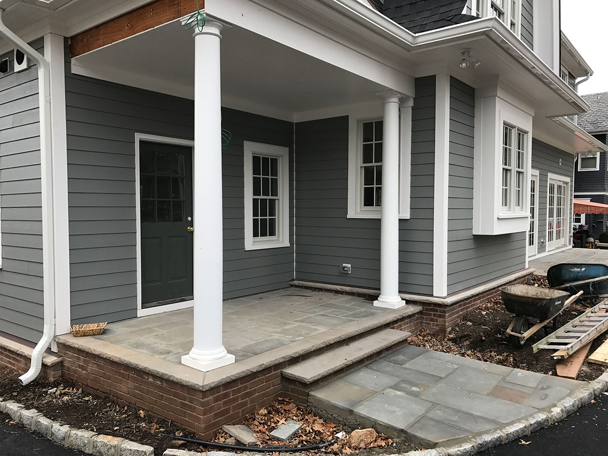 Stone porch and brick foundation